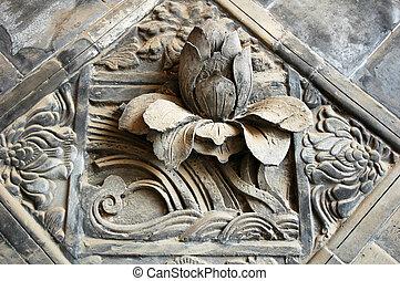 Ancient brick carving art of lotus
