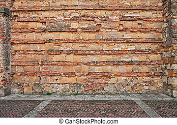 ancient brick wall and paved sidewalk