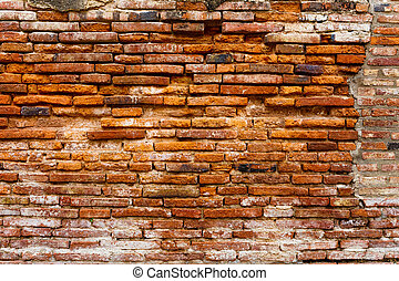 Ancient brick wall in red color