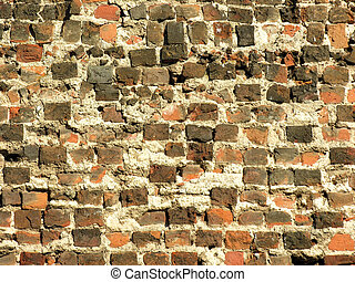 Ancient brick wall - Old brick wall with visible damage and...