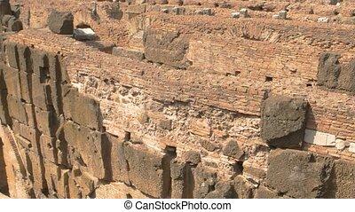 Ancient brick walls. Ruins of Roman Coliseum, hypogeum.