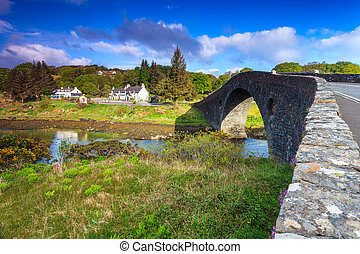 Ancient bridge in a village by the river