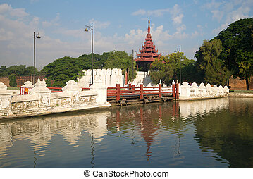 Ancient bridge leading to the gate of the Old city. Mandalay, Myanmar