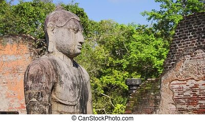 Ancient sculpture of the Buddha, inside the walls of the Vatadage ruins, at the palace complex in Polonnaruwa, Sri Lanka. Video 1080p