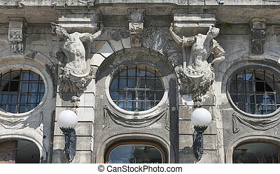 Ancient building wall with statues in Lviv