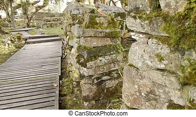 ancient buildings in Peru built with stone - Perspective of...