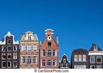 Ancient canal houses in the Dutch capital city Amsterdam -...
