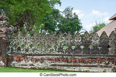 Ancient carved stone wall of the temple