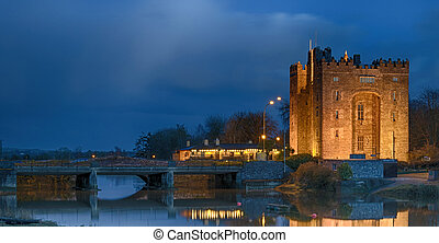 ancient castle at night  by a river in county clare ireland