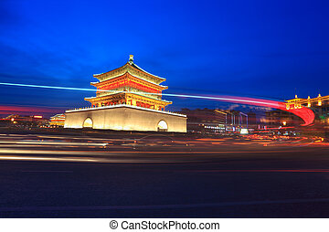 ancient city at night in xian - light trails on the ancient...