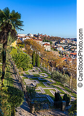 Ancient city of Porto with old multi-colored houses with red roof tiles. Portugal, Porto