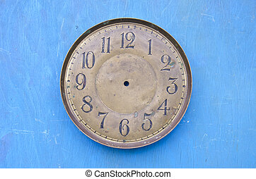 ancient clock face dial on blue background