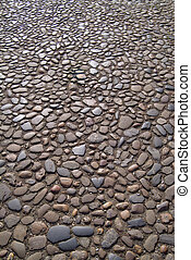 Ancient cobbles - Time-worn stone surface of English street