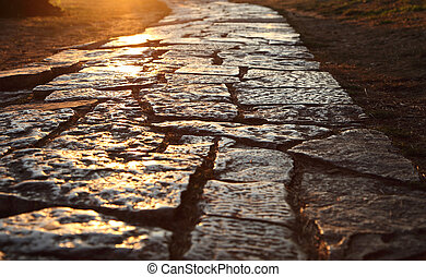 Ancient cobblestone pavement in the old town of Pula, ...