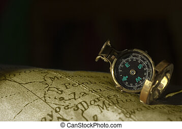 ancient compass and map background - Old compass on an old...