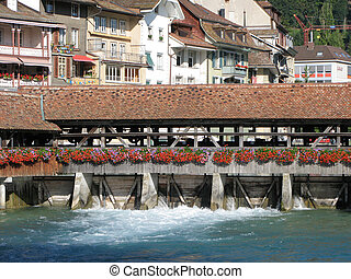 Ancient dam and wooden bridge in Thun, Switzerland