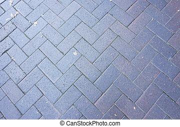 Ancient dark brown cross brick floor background