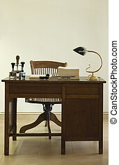 ancient desk with lamp and chair