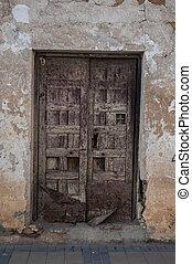 ancient door in typical spanish street, rural scene