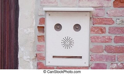 Ancient Doorbell on the brick wall
