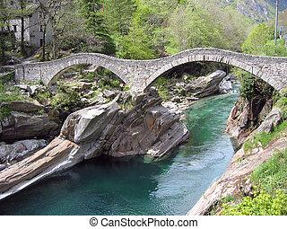 Ancient double arch stone bridge in Verzasca valley,...