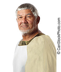 An old man in ancient garment resembles an emperor of days gone by.