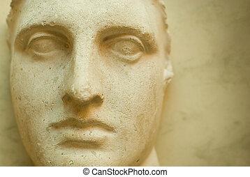 Ancient face - Ancient sculpture close-up portrait at old...