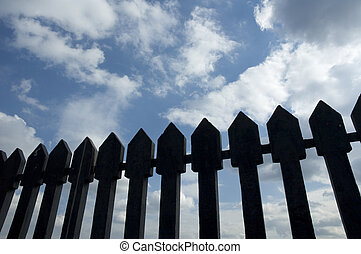 ancient fence against blue sky