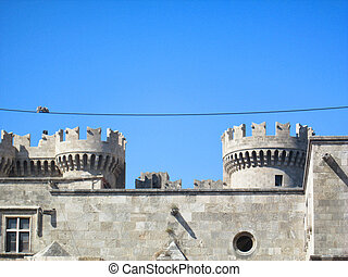 Ancient fort, two birds on a wire