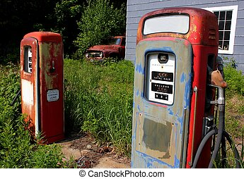 ancient gas pumps and truck