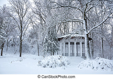 Ancient gazebo in the winter park