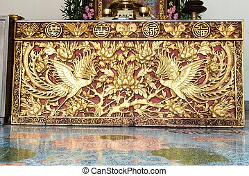 Ancient golden Chinese temple scuplture with symbolic pattern