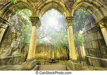 Ancient gothic arches in the myst. Fantasy landscape in Evora, P