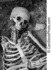 Ancient grave - Human skeleton in an ancient grave.