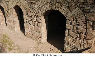 Ancient greek building with archs in ruined city of...