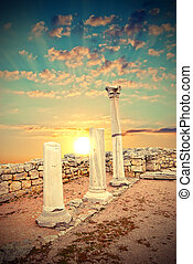 Ancient Greek columns at sunset. Vintage style