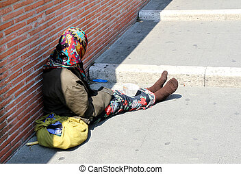 Gypsy with lurid clothes while begging on the street -...