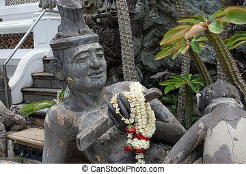 Ancient hermit statue in temple, Thailand.