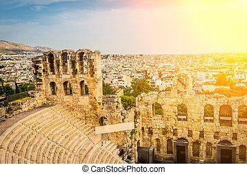 Ancient Herodes Atticus amphitheater with the cityscape on the background