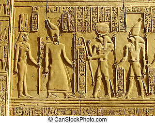 Ancient hieroglyphics on the wall of Kom Ombo temple, Egypt