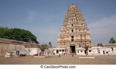 Ancient Hindu temple towering above landscape