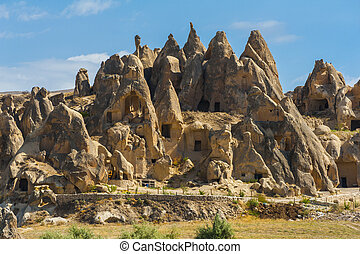 Cappadocia - Ancient homes dug into the mountains,...