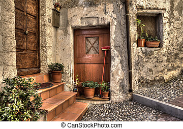 Ancient house. Ventimiglia, Italy. - Vintage wooden doors,...