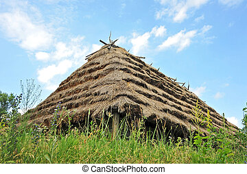 Ancient hut with a straw roof