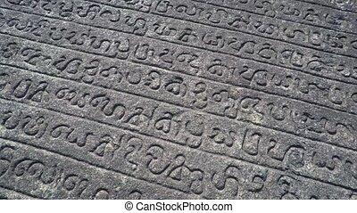 Ancient inscriptions on the Gal Pota in Polonnaruwa, Sri...