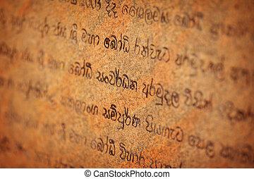 Ancient inscriptions on the temple wall. Sri Lanka