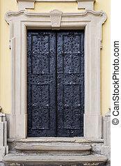 Ancient iron door, stone porch, portal and pediment. full ...