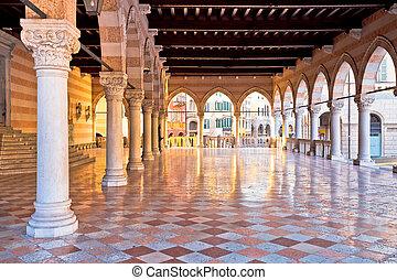 Ancient Italian square arches and architecture in town of Udine, Piazza della Liberta square, Friuli Venezia Giulia region of Italy