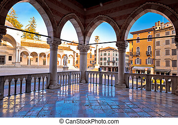 Ancient Italian square arches and architecture in town of...