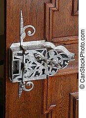 ancient keyhole in a wooden door